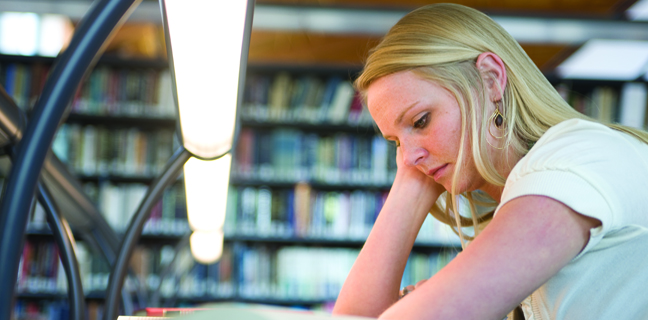 A student studies in the Law Library.