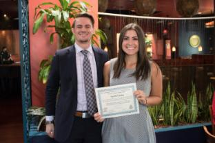 Photo of senior student Rachel Gray receiving an award