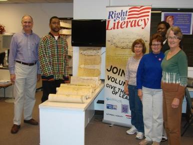 Adult Literacy Center Group photo with scroll